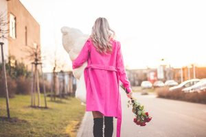 woman-with-big-teddy-bear-and-roses-walking-on-the-street-picjumbo-com
